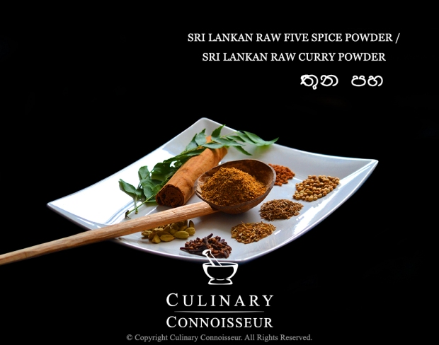 "Sri Lankan raw curry powder or ""thuna paha"", in a traditional Sri Lankan coconut shell spoon, surrounded by green cardamom pods, cloves, fennel seeds, cumin seeds, coriander seeds, fenugreek seeds, Ceylon cinnamon, a sprig of fresh curry leaves on a white plate."